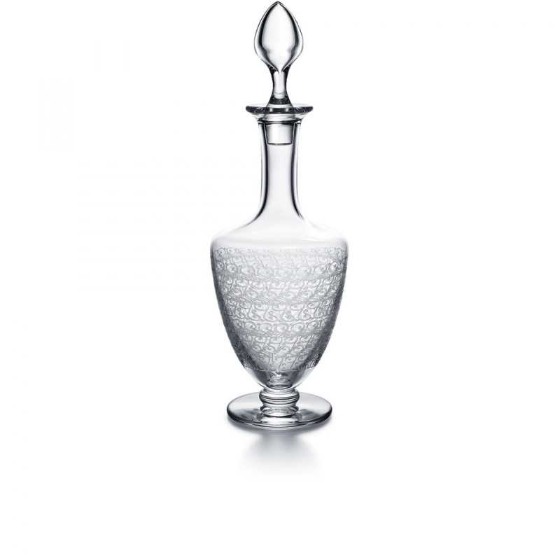 ROHAN decanter. The ROHAN collection is acid etched, giving the Baccarat crystal an elegant originality. The refined curves joined to a bevelled base make it a modern and delicate collection for the bar. The collection consists of a decanter, glasses, a champagne flute, a highball and a tumbler, and will delight liqueur and cocktail enthusiasts.
