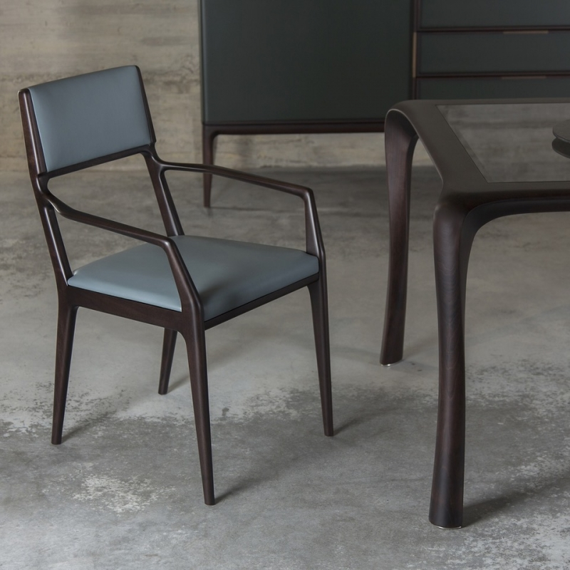 ALA chair with armrest designed by GIUSEPPE CASAROSA. Chair made in solid American walnut or ash. Seat and back-rest in upholstered poplar plywood.