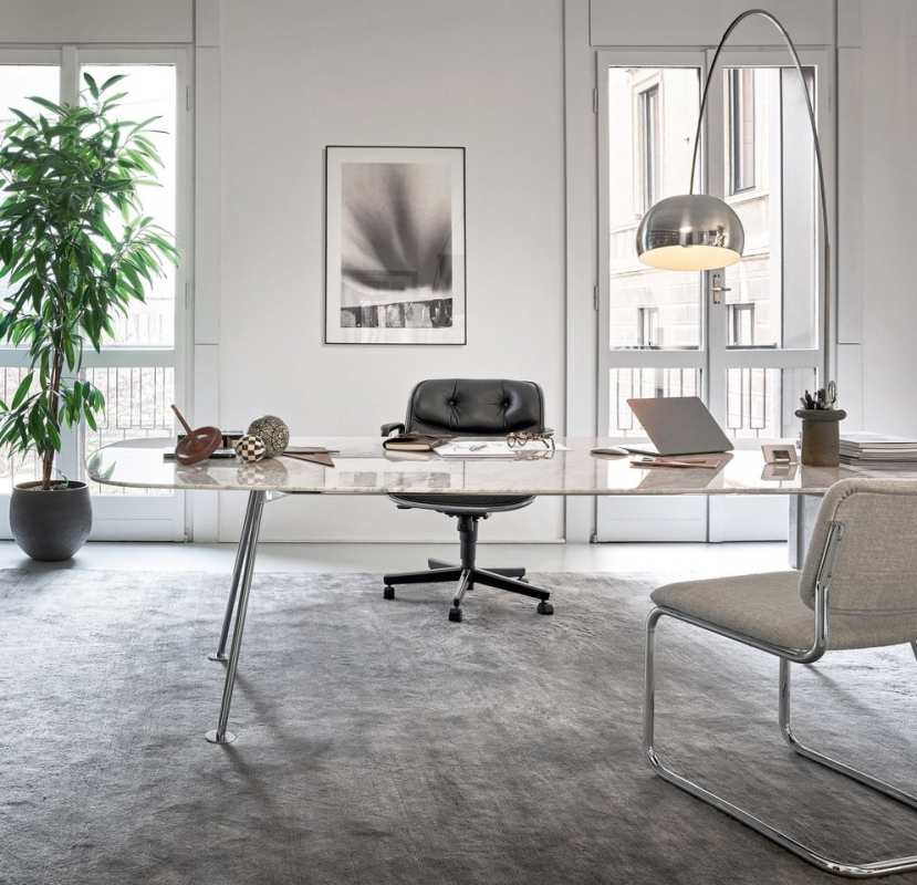 A home office for the aesthete. PIERO LISSONI'S GRASSHOPPER table, with its slender surface and organic form, adds a refined touch the elevated workspace.