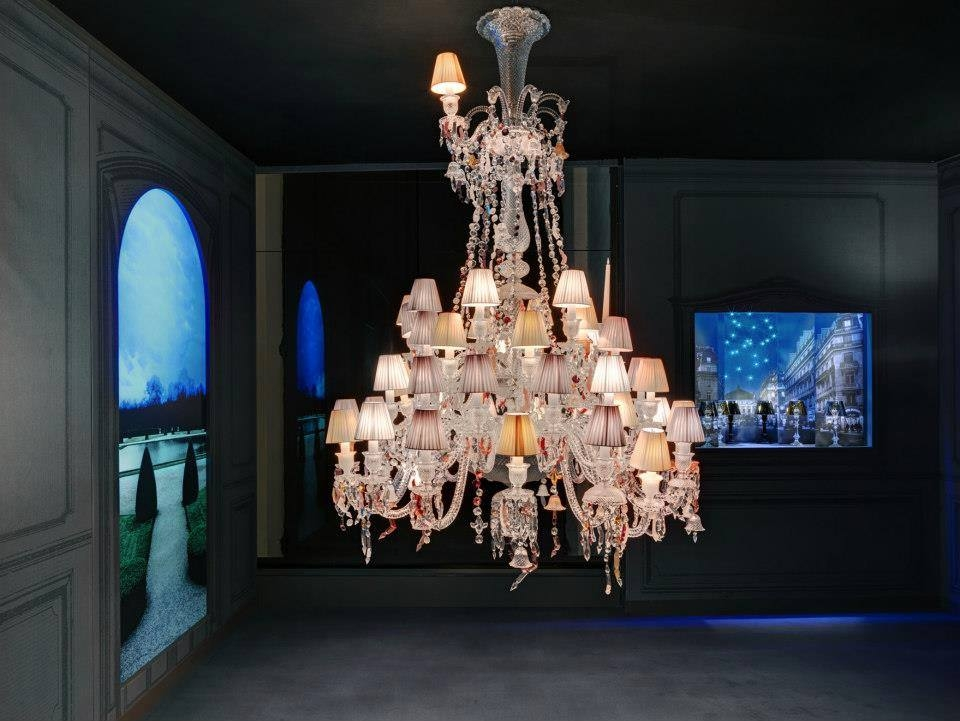 Crystal chandelier 36 lights NERVOUS ZENITH - designer LOUISE CAMPBELL, is based in clear crystal with pink, orange, red and yellow crystal elements. Available in 2 Sizes and the number of lights ranges  from 6 to 24.