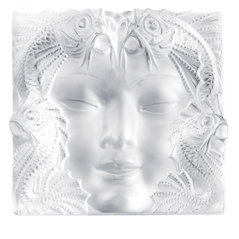 MASQUE DE FEMME PANEL,  HANDMADE CRYSTAL.THE MASQUE DE FEMME PANEL CREATED BY RENÉ LALIQUE IN 1935 TO ADORN A FOUNTAIN EMBODIES THE IMAGINATIVE POWER OF ITS CREATOR WHO WAS FASCINATED BY WOMEN AND NATURE. BOTH CLASSIC AND AVANT-GARDE, THIS PIECE OF ART REVEALS THE FACE OF A MYSTERIOUS WOMAN WITH DELICATE FEATURES, SURROUNDED BY AQUATIC FAUNA.
