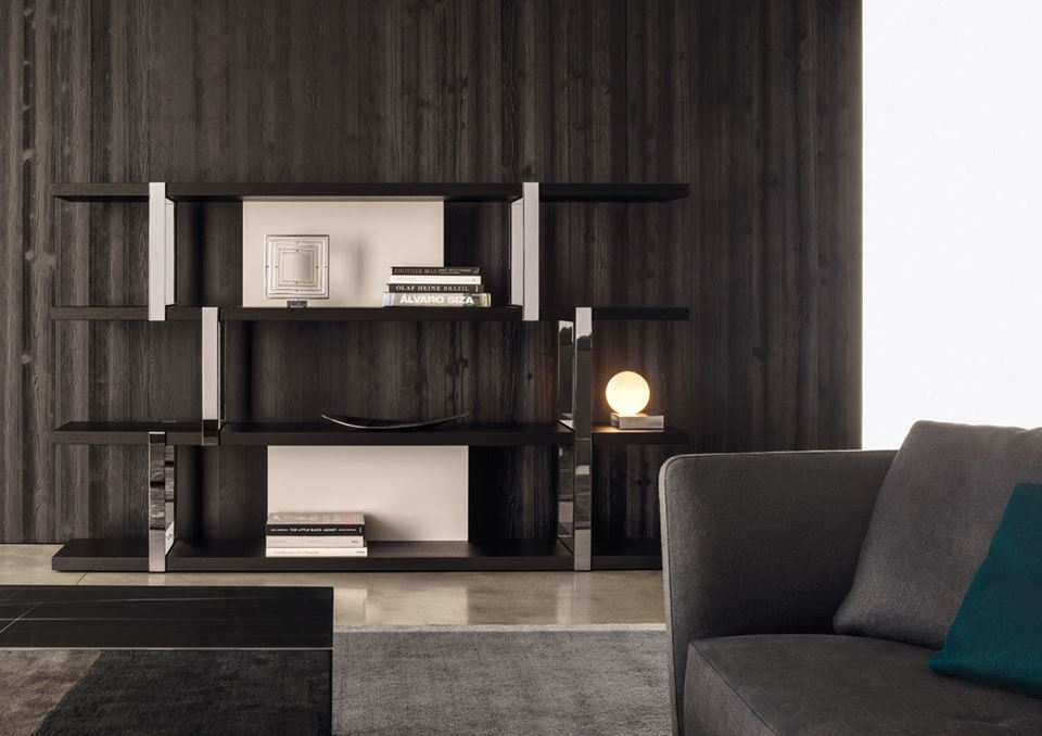 DALTON CHROME BOOKCASE THAT CAN BE THE STAR PLAYER IN ANY LIVING SPACE, THANKS TO THE NEW FINISHES THAT LEND IT A STRONGLY CONTEMPORARY DECORATIVE ALLURE. BOOKCASE COMES IN A SERIES OF NEW FINISHES THAT MULTIPLY THE NUMBER OF WAYS IT CAN BE USED AND LEAD THE WAY TO NEW STYLISTIC INTERPRETATIONS. THE NEW FINISHES INCLUDE THE POSSIBILITY OF HAVING THE BACK PANELS FINISHED IN WARM GREY OR GRANITE GLOSSY LACQUER, WHILE THE THICK SHELVES ARE AVAILABLE IN BLACK SAND-BLASTED OAK. THE VERTICAL METAL SUP