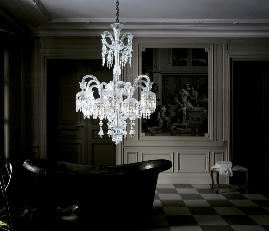 Crystal chandelier 18 lights SOLSTICE. The bellcaps at the ends of the branches imbue a graceful weightlessness. Available in 2 sizes. The number of lights ranges widely, from 6 to 48. Regardless of density, each chandelier is composed of hollow branches crafted from blown cabled crystal, resplendently showcasing Baccarat's masterful craftsmanship. The wealth of decoration is all cut in a diamond-point design. Amongst the spiked prisms, Baccarat signature's red octagonal crystal hangs discreetly.