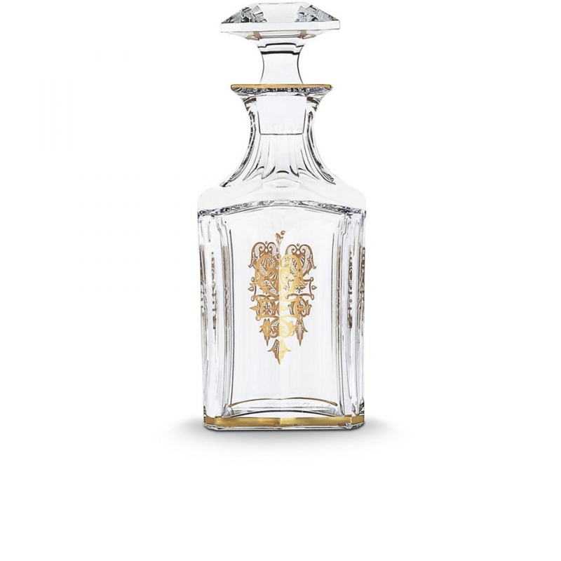 HARCOURT EMPIRE whiskey decanter. With its golden details delicately applied to the crystal, the HARCOURT EMPIRE bottle will delight whiskey lovers, for an elegant tasting. HARCOURT was created in 1841 and is the oldest service in the Baccarat catalogue. Gold motifs have been applied to each flat cut by hand, and a gold trim delicately decorates one side. The bevelled, diamond cut stopper adds a touch of geometric sophistication to this classic shape. The HARCOURT EMPIRE collection is a perfect illustration of gleaming, luminous crystal decorated with gold detail, and also includes a wine glass, a cocktail glass, a champagne flute and a wine decanter.