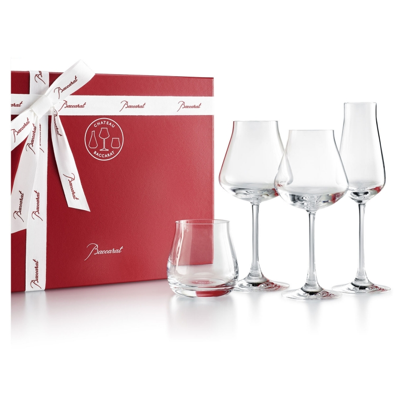CHÂTEAU Baccarat degustation set. Developed in collaboration with BRUNO QUENIOUX, a renowned wine expert, the CHÂTEAU Baccarat set of oenological glasses is revolutionizing wine tasting. The rounded and curved cup of the glass preserves the harmonization of aromas and the condensation of alcohol content: subtlety wins the day over potency and sublimates the act of tasting. Presented in the emblematic red coffret, this box of 4 glasses accompanies all those truly exceptional moments. A champagne flute to add sparkle, two wine glasses and to enhance every grand vintage, and a tumbler to unveil the very essence of spirits. Price €210