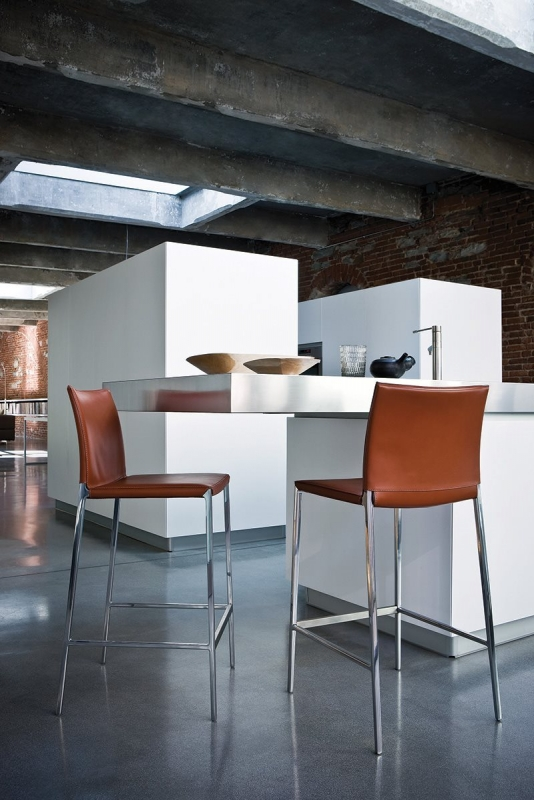 BARCHAIR  LIO BY ROBERTO BARBIERI 2005. THEY ARE THE EXTENSION OF THE LUCKY DESIGN OF LIA AND LEA CHAIRS, REMINDING BOTH THEIR SHAPE AND CONSTRUCTIONAL MATRIX: AN ELEGANT AND OUTSTANDING SIDE MADE OF ONE SINGLE ALUMINUM DIE-CAST. THEY COME WITH A PAINTED FRAME (LIO) OR ENTIRELY COVERED IN LEATHER OR COWHIDE (LEO). IN ORDER TO BETTER FIT THE VARIOUS USE SITUATIONS, HOME AND CONTRACT, THEY ARE AVAILABLE IN TWO DIFFERENT HEIGHTS.
