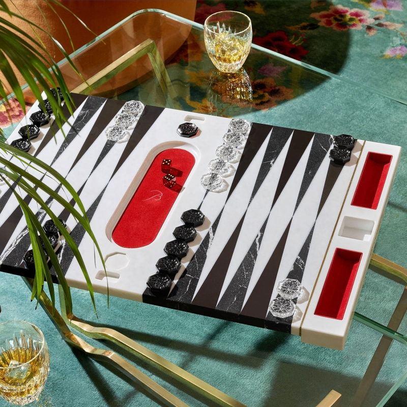 Designed by MARCEL WANDERS STUDIO in a numbered edition for Baccarat, the BACKGAMMON GAME shows a new precious look. Board in inlaid marble, dice, doubling cube and pieces in crystal.  Live with passion, have fun, forget the rest. Being together and enjoying precious time with friends. With his imaginative style, light-hearted universe and joy of living, MARCEL WANDERS STUDIO has transformed Baccarat into a playground of glamour.