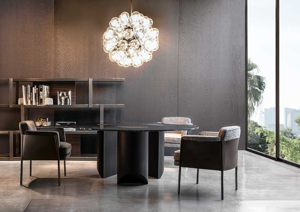 SHELLEY DINING ARMCHAIR BY GAMFRATESI easily combines compact proportions with a contemporary aesthetic taste.