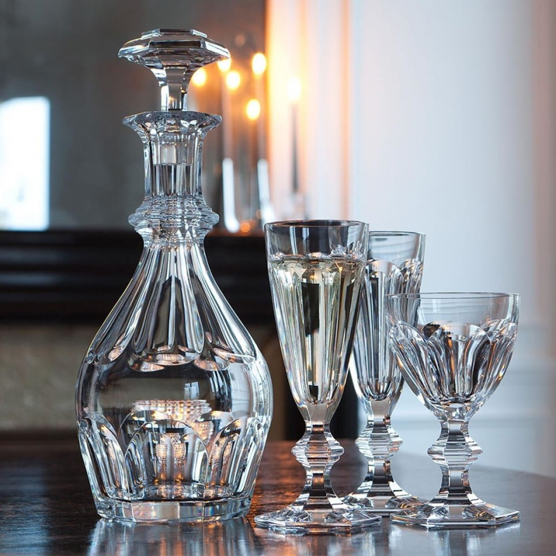 HARCOURT collection.Since its creation in 1841, the storied and elegant HARCOURT 1841 stemware has been selected by Pope John-Paul II the Queen of Thailand, the King of Morocco, and many other important figures. This clear crystal HARCOURT 1841 decanter has an exquisite silhouette. Baccarat's craftsmanship is apparent from every angle, as the architectural form creates extra visual depth. The classical shape has a requisite HARCOURT 1841 hexagonal base and refined beveled cuts. The diamond-cut stopper crowns the decanter with sophistication. It is available in two sizes, small and large. The HARCOURT 1841 collection extends to highballs, tumblers, and champagne flutes for the smoothest of drinking experiences.