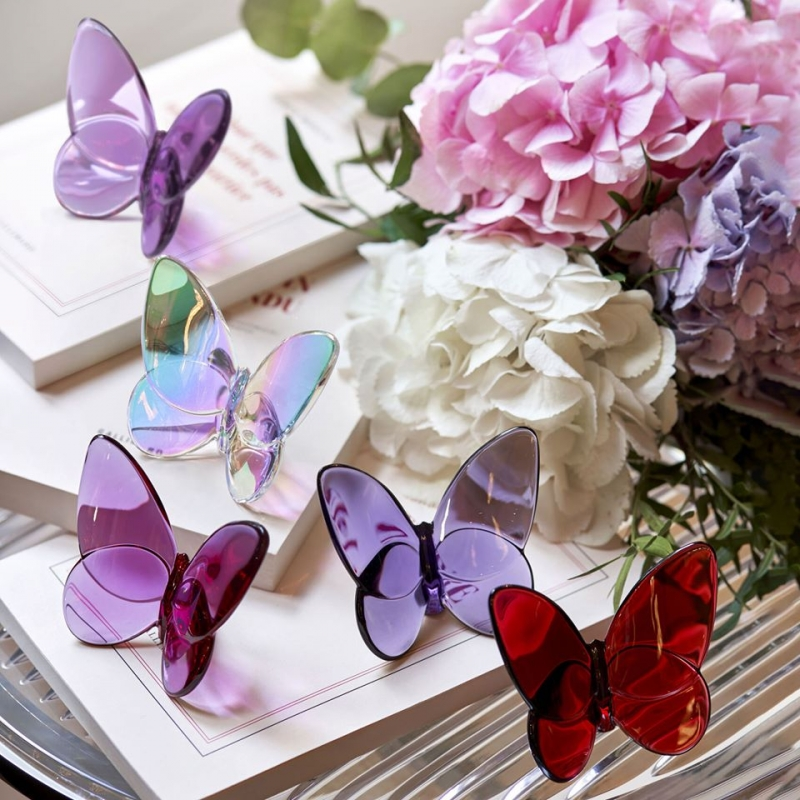 PAPILLON LUCKY BUTTERFLY. Poised to flutter off, the Baccarat crystal butterfly glints vibrantly with bright color. The wings fan out grandly, echoing the shape characteristic of the Amazonian breed. Price from €140 to €195