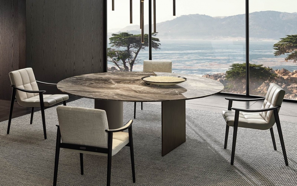 LINHA DINING TABLE by MARCIO KOGAN (STUDIO MK27), designed in 2020. In the round top version, the cross-section of the blade-like legs is not rectangular, but slightly curved on the inside.