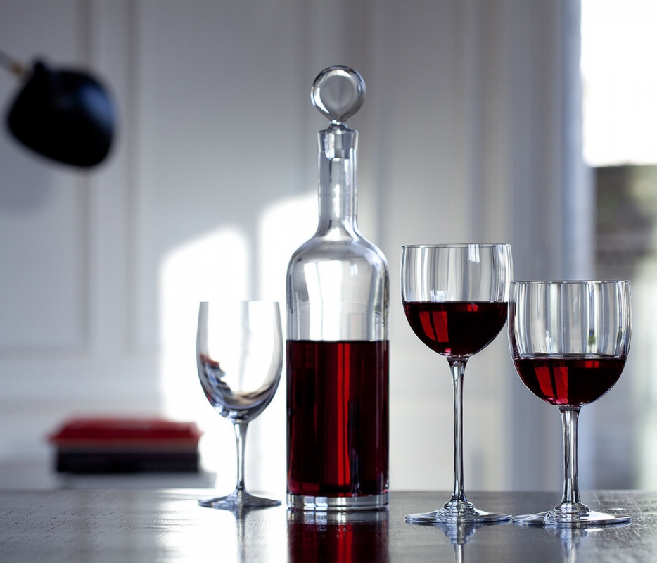 DYONISOS decanter designed by VAN DAY TRUEX. Decanting a young wine allows its undertones to flourish, and decanting may also be a fitting option for an older wine that has yet to attain complete maturity. The DIONYSUS decanter is not only a vehicle that helps the wine reach its full integrity; it is also a stunningly crafted piece. The minimalist silhouette resembles a clear crystal Bordeaux wine bottle. The poise of the slender neck morphs gracefully into the base, and the stopper caps off the sleek form with a perfectly rounded globe of Baccarat clear crystal. Designed by VAN DAY TRUEX, the understated shape matches seamlessly with any Baccarat bar and stemware set.
