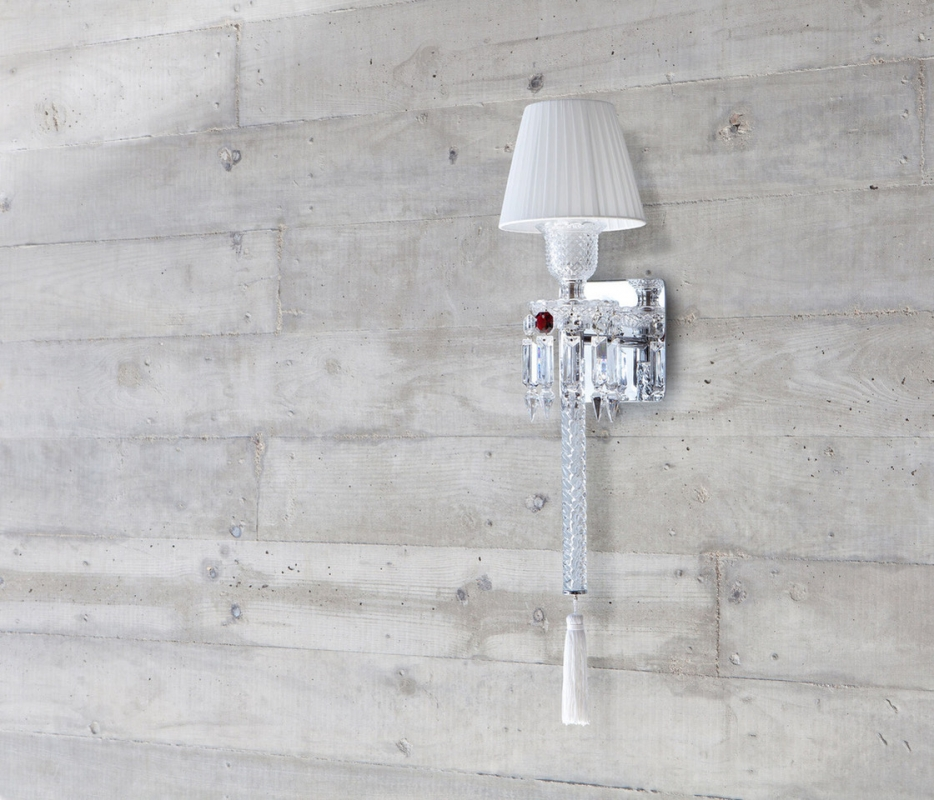 ORCH wall scone. Designed by ARIK LEVY, the TORCH wall lamp topped by a lampshade with pleated taffetas was inspired by the emblematic Zénith chandelier, which it partly reinvents.