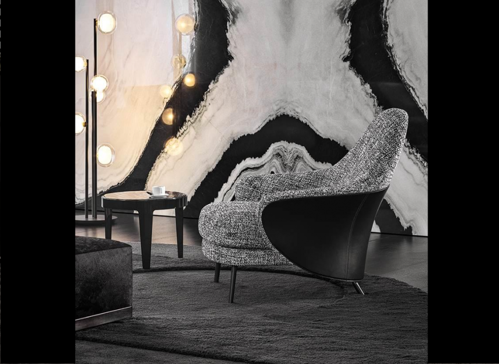 ANGIE ARMCHAIR by GAMFRATESI STUDIO, designed in 2019. The GAMFRATESI STUDIO, signing the design, worked on the idea of contrast, emphasising it and juxtaposing the stiff frame of the saddle hide element with the softness of the upholstered part, which can also be seen on the back, so setting the scene for interesting colour combinations of saddle hide and fabric. The legs are in pewter-coloured die-cast aluminium and a unique bow-shaped frame connects the feet at the rear, emphasising the curve of the saddle hide body.