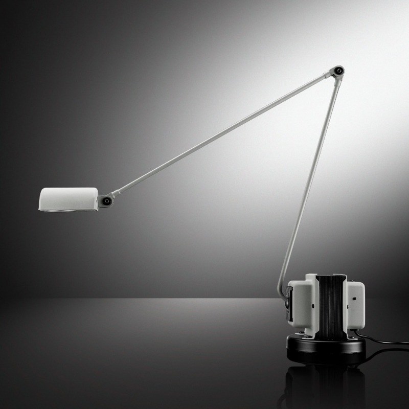 DAPHINE table lamp by TOMMASO CIMINI 1975. Since 1975 this lamp has represented the essence of Lumina. It is displayed in some of the most famous Museums of Modern Art and Design in the World.  DAPHINE is a timeless synthesis of function and form: an articulated arm, with a pivoting diffuser, mounted on a transformer. Available now with LED version, identical to the CLASSIC DAPHINE in shape and in movement, but with a more powerful light against lower consumptions. Table standing lamp in metal an articulated arm and diffuser pivoting on 360°. The base of cast iron comes black varnished. Available with LED light source. Two step switch and dimmer.  This true icon of design has earned its place in the world's major design and contemporary art museums, including the Brooklyn Museum and Judd Foundation in New York, the Musée des Arts Décoratifs in Paris, Die Neue Sammlung in Munich and The Israel Museum in Jerusalem.