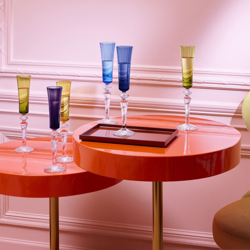 MILLE NUITS flutissimo set designed by MATHIAS. A set of 4 Flutissimo champagne flutes: blue, moss, red and amber. Slightly curved lines & flared optic glass enhance the reflection of light and give the flutes a charming style.  A powerful crystal expression thanks to its narrow cut bevels. The baroque spirit of the MILLE NUITS collection refers to the world of tales from the Thousand & One Nights. This collection expresses all the charm of the mythical Orient: THE VENETIAN STYLE evokes the richness of magnificent fabrics found in palaces, and the narrow cut brings to mind the delicate glittering of light.  Price of the set € 1140.