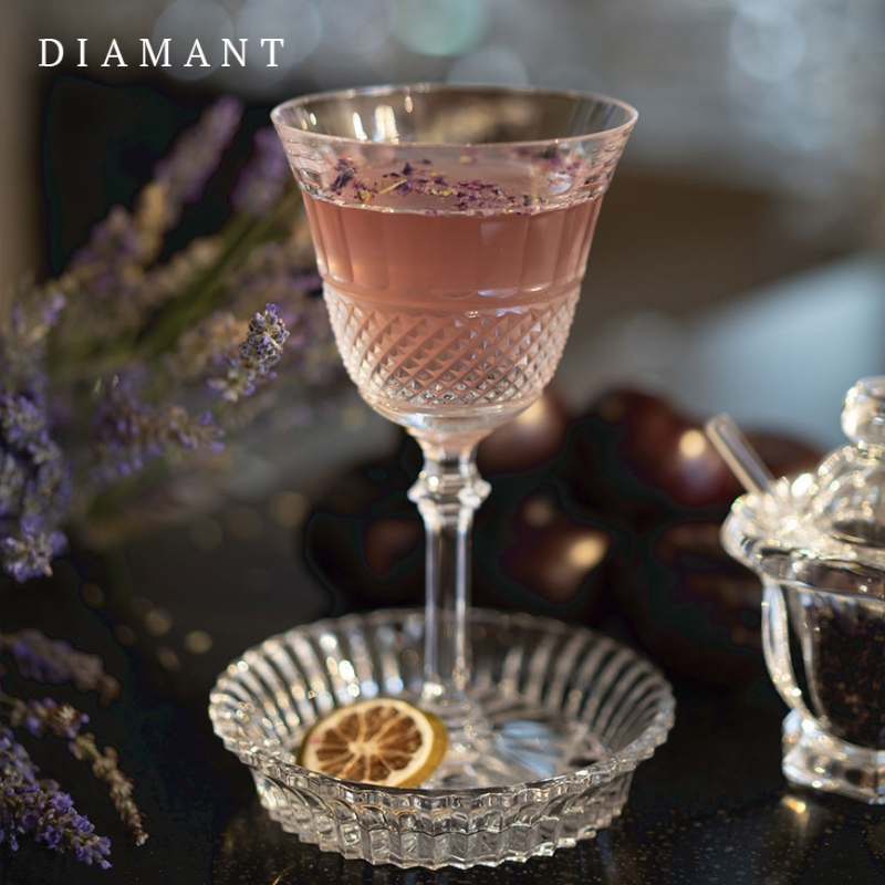 DIAMANT glass. THOMAS BASTIDE'S stylish clear crystal DIAMANT collection draws inspiration from Baccarat heritage in reviving the charm of the pointed diamond cut to complement the slender, graceful forms of this glass. The glass is shaped in a glittering display of baccarat craftsmanship. The striking design stands out as a timeless baccarat classic. The collection comprises glasses in four sizes and a champagne flute as well as a set of three matching tumblers.