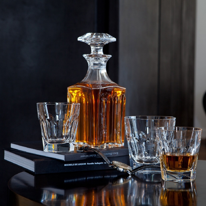 HARCOURT 1841 whiskey decanter. Since its creation in 1841, HARCOURT 1841  temware has been selected by Pope John-Paul II, the Queen of Thailand, the King of Morocco, and many other important figures. Sipping from a HARCOURT  841 glass is taking part in Baccarat's storied and elegant past. This Clear crystal HARCOURT SQUARE WHISKEY  ecanter has an exquisite silhouette. Baccarat's craftsmanship is apparent from every angle, as the architectural form of the decanter creates extra visual depth. The diamond-cut beveled stopper crowns the classical shape with extra geometric emphasis and sophistication. The HARCOURT  841 collection extends to highballs, tumblers, and champagne flutes for the smoothest of drinking experiences. Price €910.