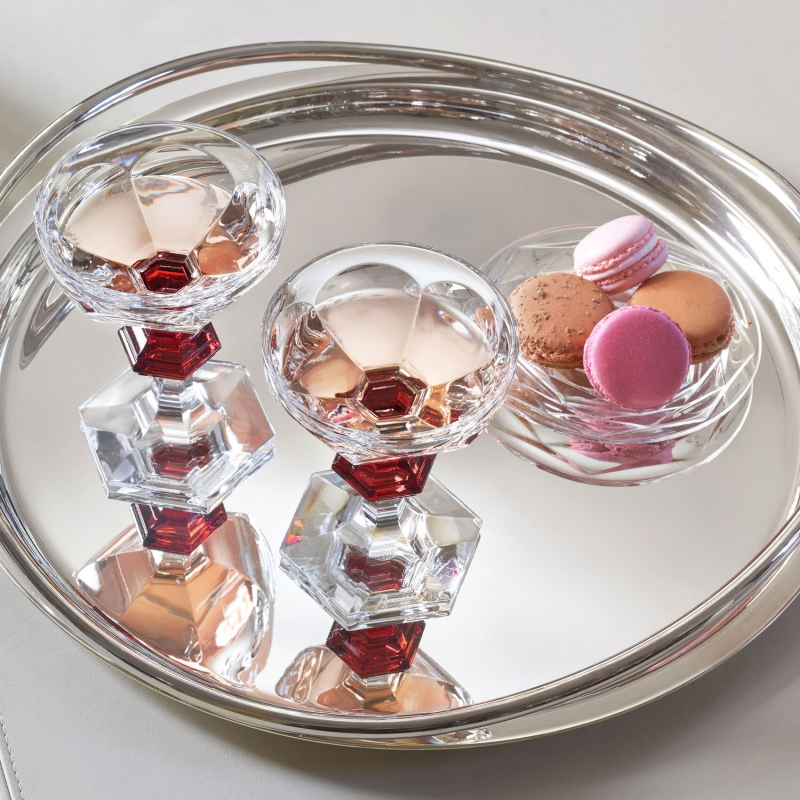 HARCOURT 1841 champagne coupe.Legendary glass, star of all exceptional parties, the HARCOURT CHAMPAGNE coupe is adorned with a red button, single-handedly embodying Baccarat's know-how and glamorous art of living