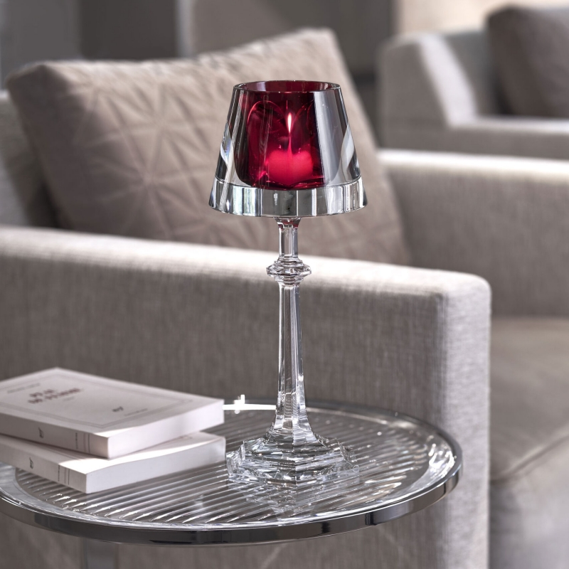 HARCOURT MY FIRE candlestick red. Set in a transparent light-shade, a HARCOURT red goblet now serves as a votive. Filtered by magic crystal, the candle creates an enchanting atmosphere. A collector's item for all lovers of creative design. Price €750