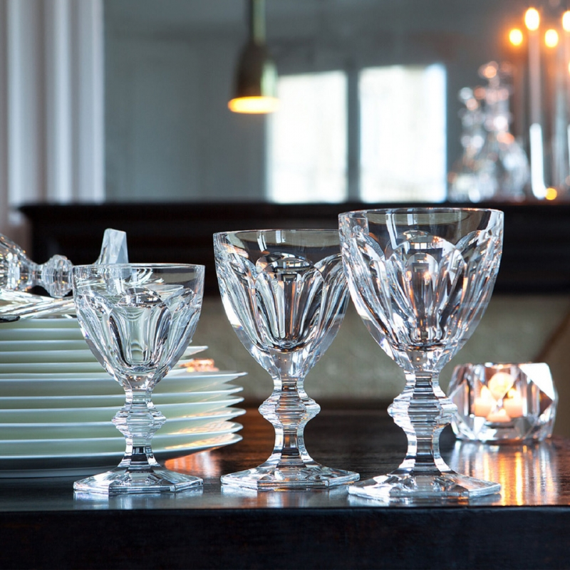 The HARCOURT 1841 collection, the oldest in the Baccarat archive, is reputed for its iconic design. Created in 1841, HARCOURT stemware has been chosen by historical icons. The HARCOURT 1841 collection has also been a staple of French power, selected since the age of Napoleon III to its contemporary use in the Palais de l'Élysée. The HARCOURT 1841 glass is characterized by its architectural form: a stunning shape from the flat cut pattern of the bowl to the beveled geometry of the stem down to the hexagonal foot. Its craftsmanship is apparent from every angle of its regal and graceful form. Sipping from a HARCOURT 1841 glass is taking part in the brand's storied and elegant past.