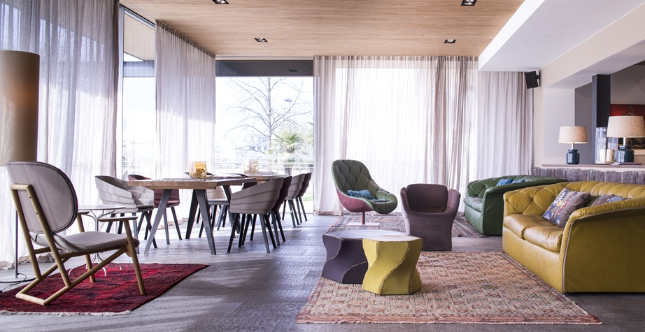 BOHEMIAN SOFA AND ARMCHAIR, BLOOMY SMALL ARMCHAIR, RIFT CHAIR AND KLARA ARMCHAIR BY PATRICIA URQUIOLA; TWIST AGAIN STOOL BY KARMELINA MARTINA - HOTEL MUCHELE, MERANO, ITALY, 2015.  INTERIORS: MOROSO CREATIVE TEAM WITH ARCHITEKTEN STEPHAN MARX ELKE LADURNER ARCHITECTURE: ARCHITEKTEN STEPHAN MARX ELKE LADURNER