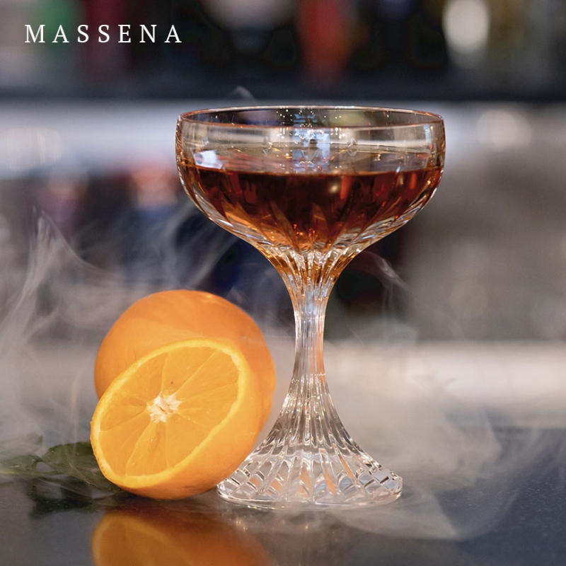 The MASSENA crystal champagne coupe showcases Baccarat's meticulous craftsmanship.