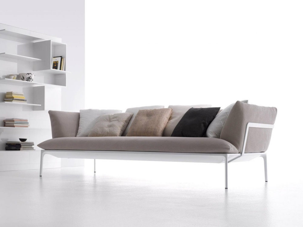 YALE SOFA by JEAN-MARIE MASSAUD, designed in 2009–2011. A minimal structure of extruded aluminium embodies reduction and lightness. Cradling cloud-like pillows, it supports a solid seating system with firm cushions. MASSAUD's vocabulary for this line also translates into low coffee tables, both square and rectangular. The designer's YALE COLLECTION of sofas, armchairs, and tables synthesizes form, function, and beauty, personalized pieces with varied colours, densities, and materials. MASSAUD has done more than simply design a product. He has imagined a way to enhance how people live. YALE SOFA by JEAN-MARIE MASSAUD was awarded the Compasso D'Oror Award in 2011.
