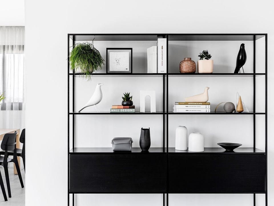 MINIMA 3.0 by BRUNO FATTORINI, designed in 2013–2019. MINIMA 3.0: three stands for the three key elements that compose the system: shelf, frame, cabinets. Essential and flexible, MINIMA 3.0 represents the natural makeover of MINIMA, MDF Italia collection's icon product, special mention at the XVII Compasso D'Oro ADI in 1998. Technology and innovation have enabled this thin aluminium structure, to propose an increasingly minimal yet strong identity. Today MINIMA 3.0 evolves and renews, turning into a more versatile and adaptable furnishing system, capable of joining more functions. The new MINIMA 3.0 is divided into 5 types: ground-resting, hanging, sketch, sideboard and room divider.