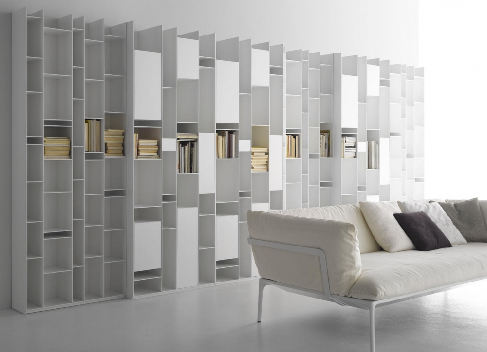 RANDOM BOOKSHELVES by NEULAND INDUSTRIEDESIGN, designed in 2017. An icon, an industrial masterpiece with an extraordinary irregular structure.  A piece of furniture that, when it was born in 2005, revolutionised the concept of bookshelf, turning it into a design sculpture. This is the visiting card of RANDOM by NEULAND INDUSTRIEDESIGN, created all white at the beginning. Then, it came in different variants up to the colour of the 2C-3C release. A product that, with its geometries, favours light games, while with its modularity adapts to any living space, from the widest to the most reduced ones. Over the years, RANDOM has extended its family, changing the concept of storage. For instance, with RANDOM BOX and RANDOM CABINET, objects can be both stored and shown off, while modules of different depth give an effect of considerable dynamism. Even today, MDF Italia RANDOM expresses an extraordinary communication energy and it is one of the icons of the whole design world.