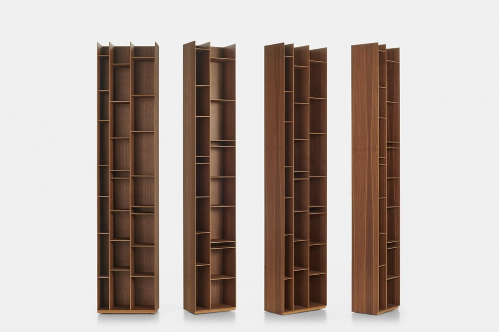 RANDOM WOOD 2C - 3C BOOKCASES by NEULAND INDUSTRIEDESIGN, designed in 2020. A new refined Canaletto walnut finish dresses the iconic RANDOM bookcase in the 2C-3C version. An elegant texture with darker veins enhances the natural beauty of the wood, giving a warm and welcoming atmosphere to the environments in which it is installed, from the living room to the dining room. Thanks to its timeless character, the new RANDOM WOOD 2C-3C adapts harmoniously to any context and style, from the most classic to the most modern, characterizing every interior with personality.  Designed in 2005 by NEULAND INDUSTRIEDESIGN, RANDOM is an icon of the MDF Italia collection which expanded its range over the years with the introduction of the 2C and 3C options in 17 shades. A modular bookcase, which can be used individually for small spaces, or in combination with other colour shades to create larger compositions.