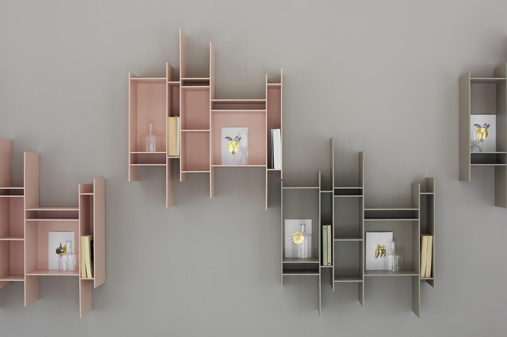"""RANDOMITO by NEULAND INDUSTRIEDESIGN, designed in 2011. A graphic sign on the wall that catches the eye. A small but endearing hanging bookcase, able to confer dynamism to any environment and embellish it as an artwork. This is the main feature of RANDOMITO, whose single and vertically reversible module can be used both individually and by aggregation, thus getting plenty of customised configurations. Also the colour palette has been added more shades over the years: not only pure white but other seven shades, including pastel ones. NEULAND INDUSTRIEDESIGN conceived a bookcase evoking movement and lightness, whose silhouette is unmistakable: one in a kind, it is inspired to the """"progenitor"""" Random, representing one of its evolutionary paths. Wonderful in residential contexts, RANDOMITO lends itself excellently to business spaces."""