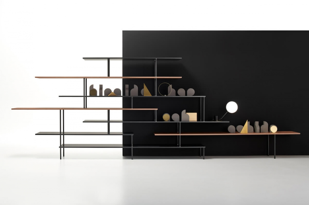 """SUPER_POSITION by Jean Nouvel Design, designed in 2018–2019. Formal lightweight, graphic sign, simple design, harmonious aesthetics, essentiality are the hallmarks of SUPER_POSITION bookcase family, designed by JEAN NOUVEL DESIGN. """"Overlapped lines are a tribute to the lightness of horizontality. Uninterrupted vertical lines cross the shelves, which extend like small diving boards into the void. Objects, vases and sculptures can express their differences of scale in empty spaces, in the niches in the middle or on the ends of the overlapped lines."""" JEAN NOUVEL SUPER_POSITION is available in a monochromatic version, two-tone or two-material version."""
