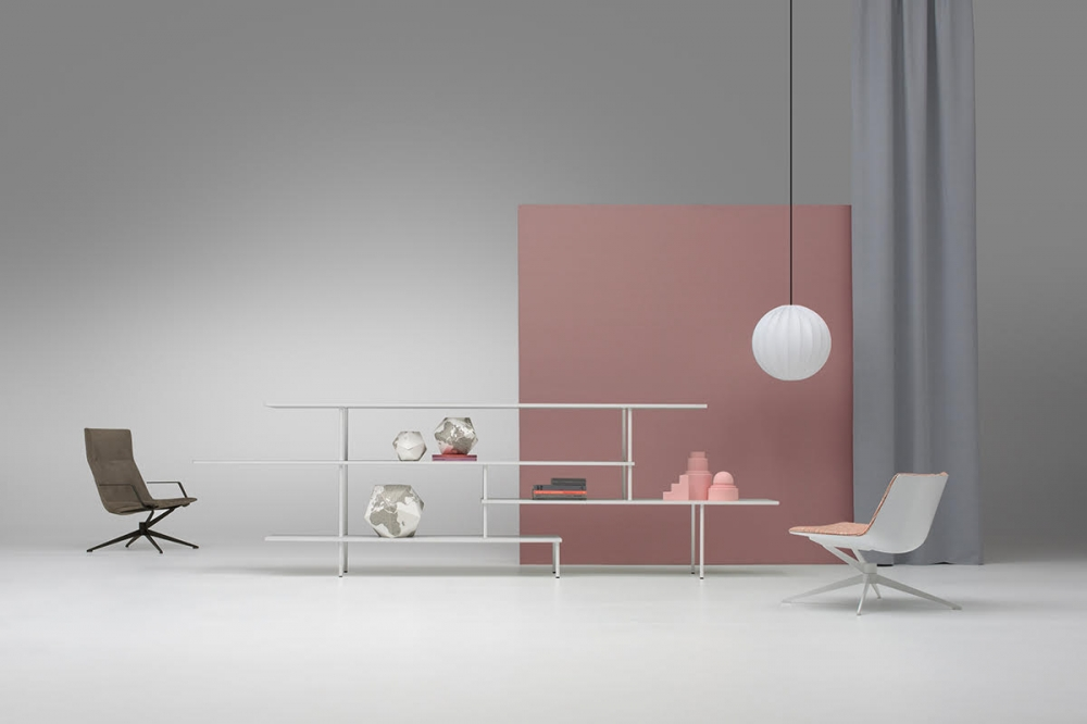 NEIL ARMCHAIR by JEAN-MARIE MASSAUD, designed in 2019. NEIL LOUNGE CHAIR and ARMCHAIR are celebrating lightness and competence. A radical language, a cosy comfort and an elegant technique that match surprisingly well with refined, natural finishes. Now introduced in a four-star version, this new collection leaves space for further future options and different situations and uses. The NEIL ARMCHAIR emerges today as a new icon of essential style. NEIL is presented in two new versions: BASIC and BASIC with RETURN MECHANISM. Two unique bases that redefine the classic office chair concept.