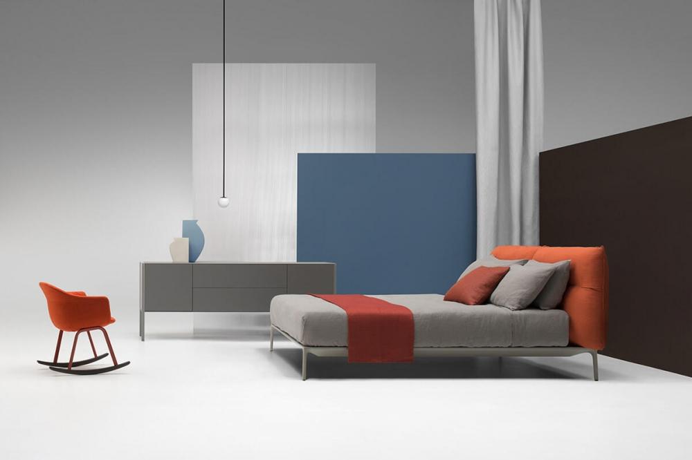 YALE BED by JEAN-MARIE MASSAUD, designed in 2018. MASSUAUD's latest creations were conceived for a functional and contemporary home, expressing a style and a way of living in which formal simplicity does not exclude creativity, quality, innovation and a sophisticated aesthetics. The designer extends YALE X's project idea to the night area, proposing again YALE's softness and comfort for the headboard, as well as the refined aesthetics of the sofa's stand as the hallmark of the bedframe. The bed concept means a welcoming headboard, capable to offer the best comfort to relax, read or watch TV, a good mattress and a comfortable pillow.
