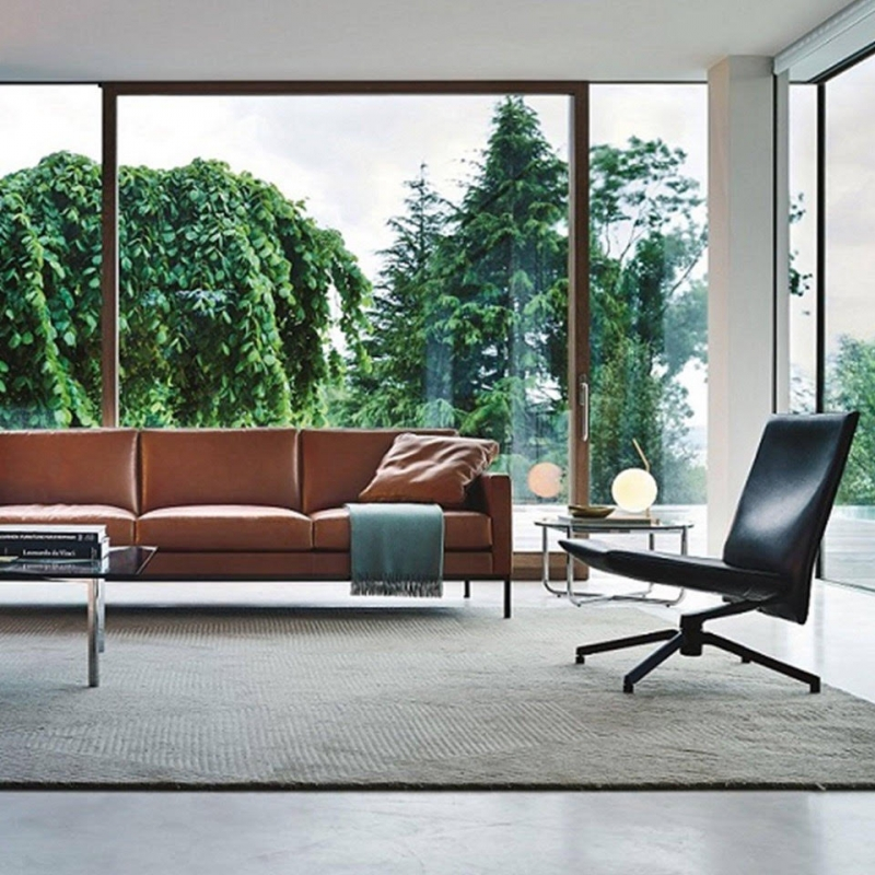 PILOT by EDWARD BARBER and JAY OSGERBY, designed in 2016. PILOT is an innovative swivel lounge chair that marries visual and material lightness with exceptional comfort. The cantilevered seat, which features a unique upholstery substructure for greater flexibility, appears to float in the air, giving the chair a refined silhouette and an essential, timeless appeal.
