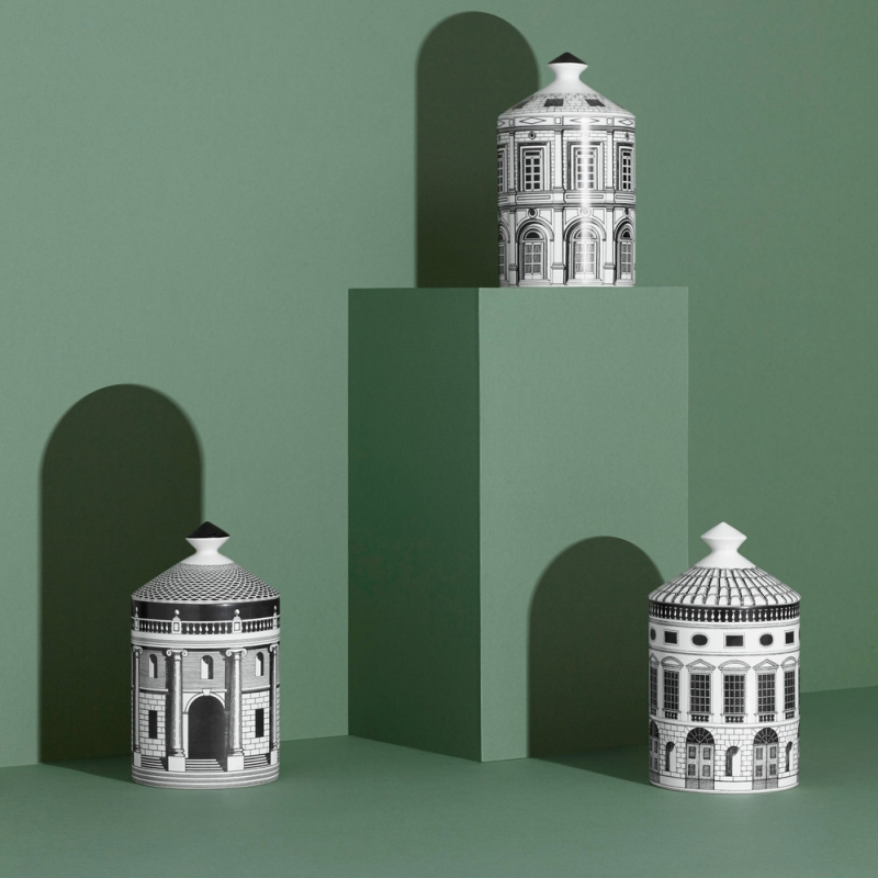 SCENTED CANDLES ORDINE ARCHITETTONICO. INSPIRED BY THE ARCHITECTURE OF ANDREA PALLADIO, EACH CANDLE HOUSES FORNASETTI'S SIGNATURE OTTO FRAGRANCE AND IS FILLED WITH 100% VEGETABLE WAX