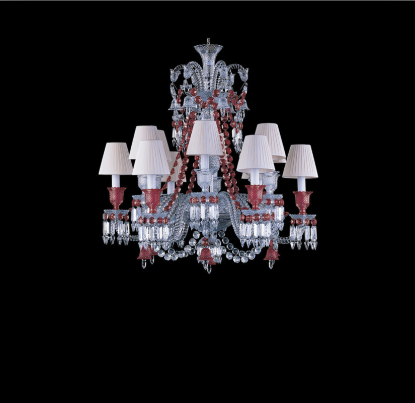 ZÉNITH RED chandelier.This chandelier, whose architecture is strictly identical to the clear ZÉNITH one, is revealed under a new light thanks to its suit of golden red crystal, iconic of Baccarat, which magnifies its ornamentations.