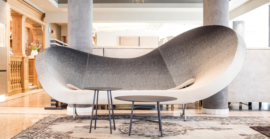 VICTORIA AND ALBERT SOFA BY RON ARAD AND TIA MARIA LOW TABLE BY ENRICO FRANZOLINI - SONNES RESORT NATURNO, ITALY, 2018  ARCHITECTURE: LOBBY PHOTO CREDIT: SONNEN RESTORT