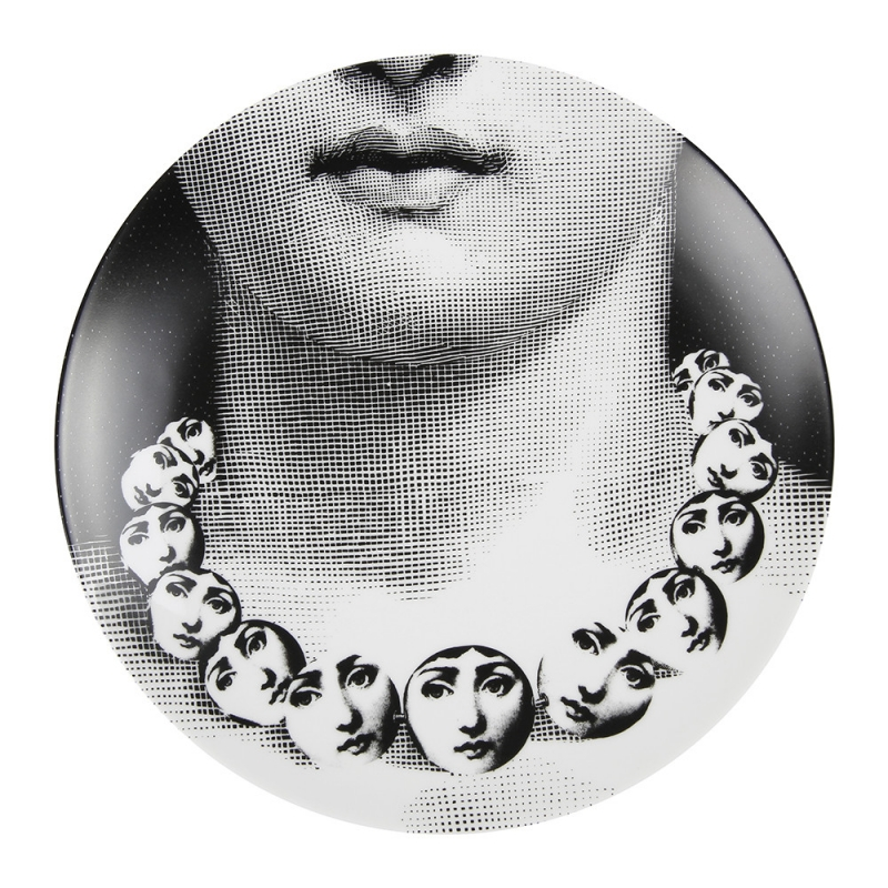 TEMA E VARIAZIONI WALL PLATE - NO. 107. THIS TEMA E VARIAZIONI WALL PLATE IS A TRULY UNIQUE PIECE OF ART FROM THE WORLD FAMOUS FORNASETTI BRAND. BEAUTIFULLY CRAFTED FROM PORCELAIN IT DEPICTS THE FACE OF OPERA SINGER LINA CAVALIERI DUPLICATED ONTO A CIRCULAR NECKLACE WORN BY HERSELF. CLASSICALLY INFLUENCED YET CONTEMPORARY IN STYLE, IT IS A STUNNING EXAMPLE OF THE DESIGNER'S ICONIC STYLE & IT MAKES A FABULOUS GIFT IDEA FOR ANY OCCASION. DIAMETER:26CM