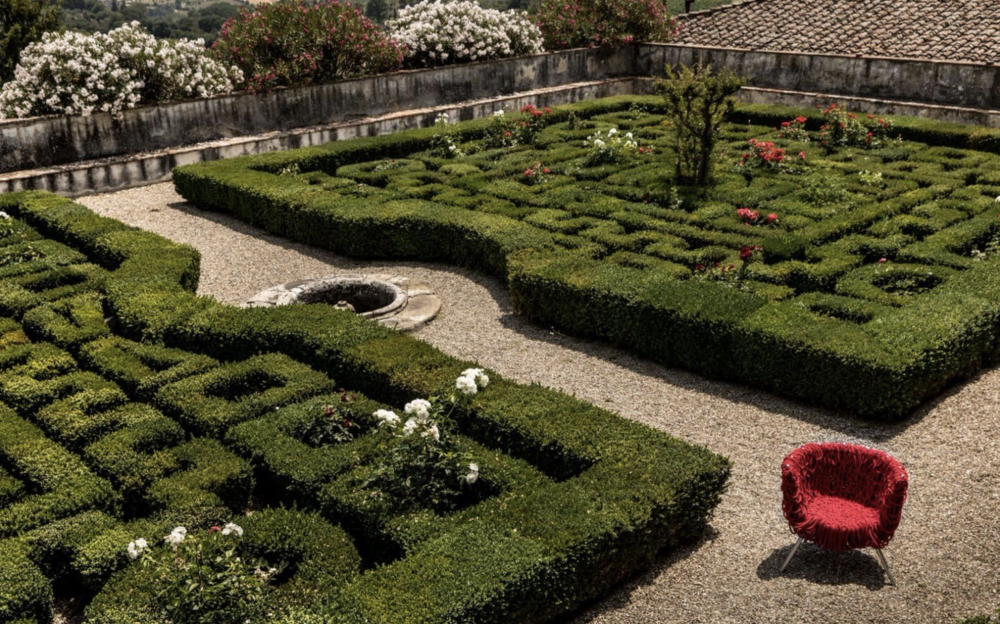 VERMELHA armchair BY CAMPANA BROTHERS. VERMELHA armchair is the main character at Villa Corsini at Mezzomonte, Florence, in a perfect example of Italian-style garden.
