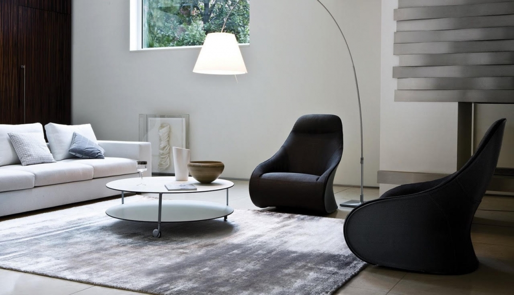 DERBY armchair by NOÉ DUCHAUFOUR LAWRENCE, designed in 2010. Armchair/bergère, pouf. Armchair with steel base, swivel or fixed with feet and stiff polyurethane external body covered with cowhide 95. Upholstery of internal body and pouf in polyurethane/ heat-bound polyester fibre with elastic strips suspension. Removable fabric or leather cover. Pouf steel frame.